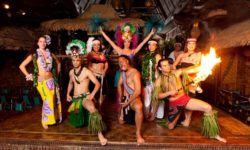 The Mai-Kai Polynesian Revue posing with fire on the stage of the Mai-Kai.