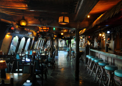 Long galley view of the Molokai Bar which is designed as a turn-of-the-century seaport saloon.