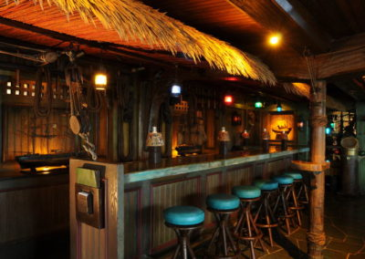 The beloved bar of the Molokai featuring ship artifacts and also lamp shades freely decorated by Mai-Kai patrons over the years.
