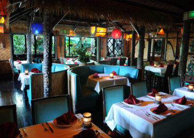 View of the Tahiti dining room with windows overlooking the Mai-Kai gardens.
