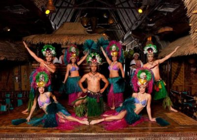 Polynesian Revue dancers in a theatrical group pose on the Mai-Kai stage.