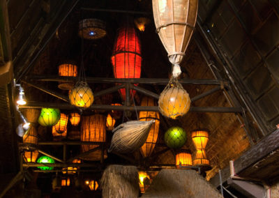 Dozens of brightly colored nautical themed lanterns glowing against the traditional thatched ceilings of the Mai-Kai.