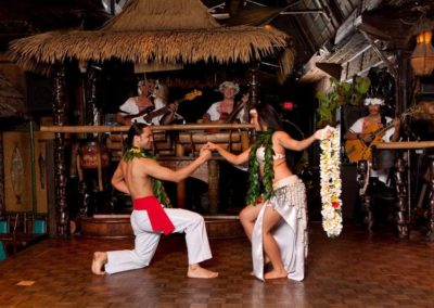 Romantic moment captured between two dancers performing the Polynesian Wedding Dance.