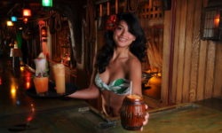Sarong clad maiden serves the Mai-Kai classic Barrel O' Rum in signature barrel mug.