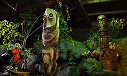 Iconic hand carved tiki sculptures featured in the indoor Mai-Kai gardens.