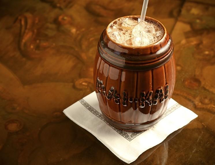 The famous Mai-Kai Barrel O'Rum drink served in its own signature ceramic barrel shaped mug.